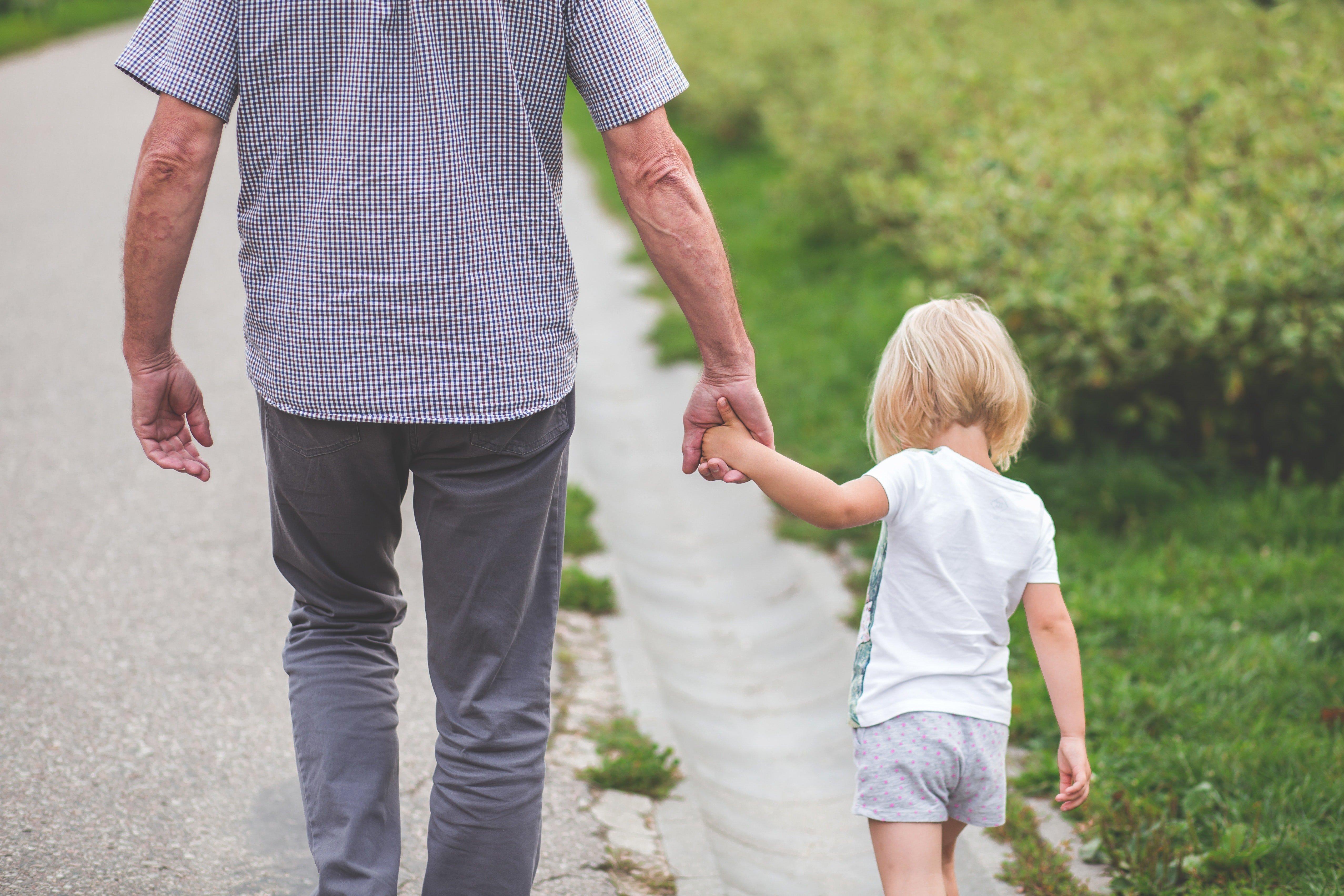 Grandparent walking with grandchild