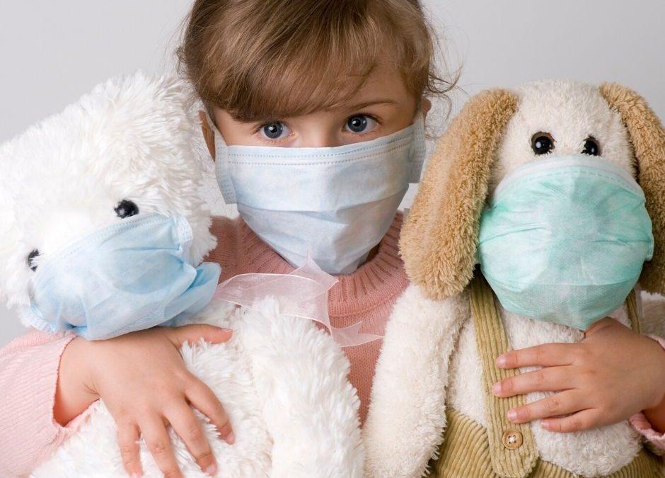 Protecting Children During Coronavirus - Masks on Child and Stuffed Animals
